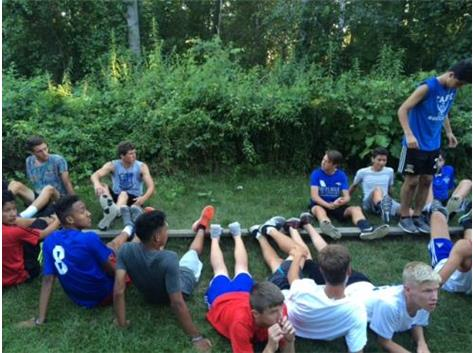 Members of the Taft Varsity Soccer Team take part in team building at Portage Lake Camp in Onekama, Michigan.
