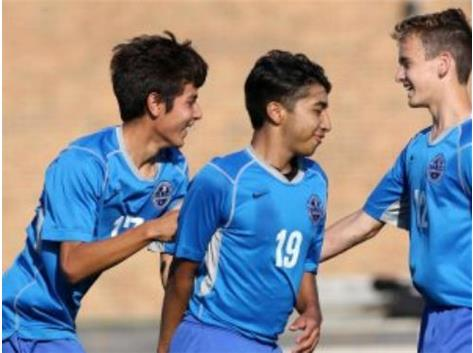 #17 Josue Carreno, #19 Andy Dominguez, and #12 Caleb Warmbier celebrate 1 of WHS's goals at Indian Creek!