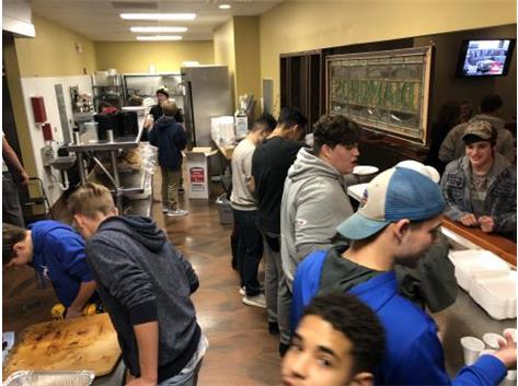 All levels and weights of WHS Wrestlers diligently preparing BBQ Dinners for friends, family, and supporters!