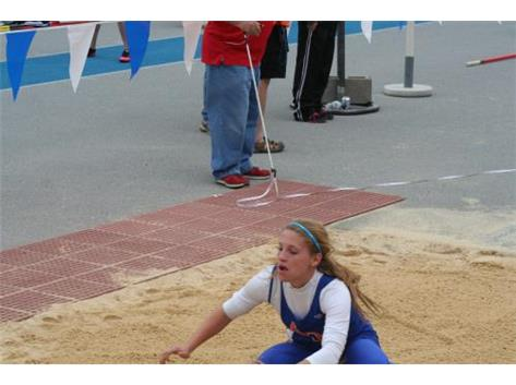 Cassie hurdling at State