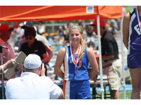 Maddie getting TJ medal