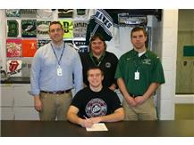 Kevin signs his national letter of intent to compete in Football and Boys Track and Field at St. Joseph's College in Indiana.