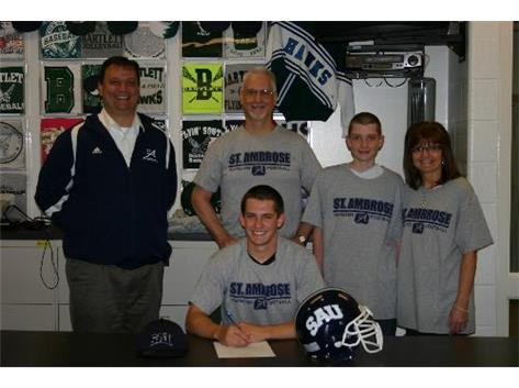 Zach Karys signs his national letter of intent to play football at St. Ambrose.