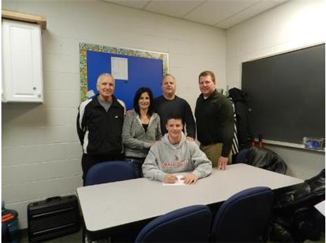 Mike Roberson signs his National Letter of Intent to play Baseball at Ball state.