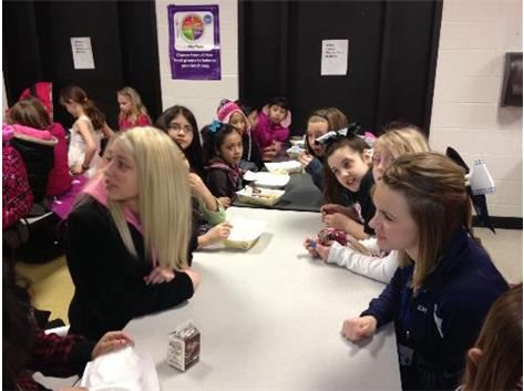 BHS athletes meet with Nature Ridge students for breakfast.