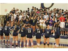 Students cheer on the Volleyball team