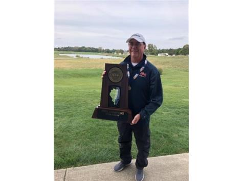 Coach with the State Championship trophy