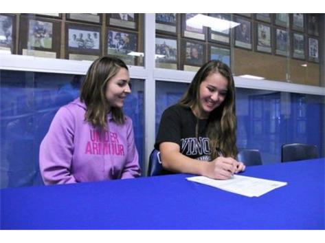 Christina Signs Letter of Intent to play softball at Winona State University.