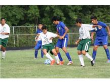 Alex Bernal trying to get the ball back