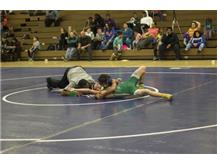 Malik Cook-Bey squeezes and sinks his opponents shoulders to the mat for a pin.
