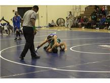 Aidan Ruiz using a 3/4 nelson to turn over his opponent