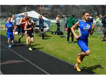 Julian is breaking away from the pack in the 1600m run.  Logan is close behind.