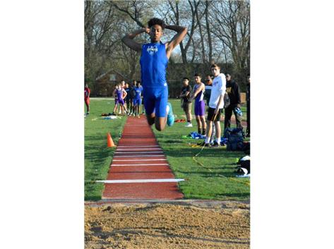 Christian is flying in the air during the jump phase of his triple jump.