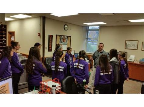 AD gives the girls a pep talk before they head to State XC Meet