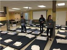 DGS Girls Soccer Seniors setting up pads, blankets, and pillows for PADS Ministry DuPage