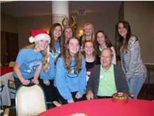 SOFTBALL PLAYERS VISIT THE ELDERLY AT OAK TRACE