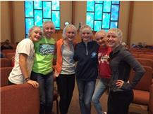 GIRLS CROSS COUNTRY HELPING OUT AT FEED MY STARVING CHILDREN