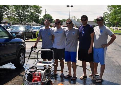 Coaching Staff at the Summer Car Wash Fundraiser.