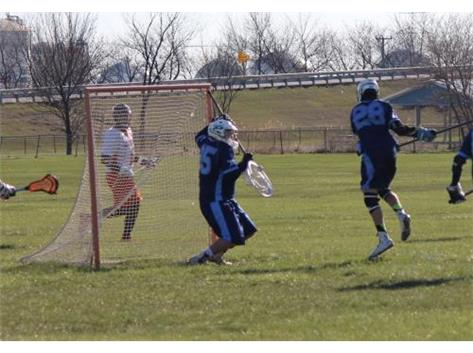 George Goldie-Morrison makes a save in their win against Minooka. Defensive Player of the year 2016