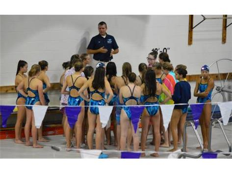 DGN Invite - Coach Krick addressing the girls