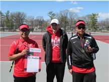 Martin Barrios & Jason Ramirez are congratulated  by Coach Fernandez for taking 1st. in doubles.
