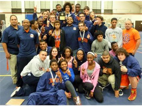 Varsity Wrestling Victorious after Day One at December ETHS Tourney