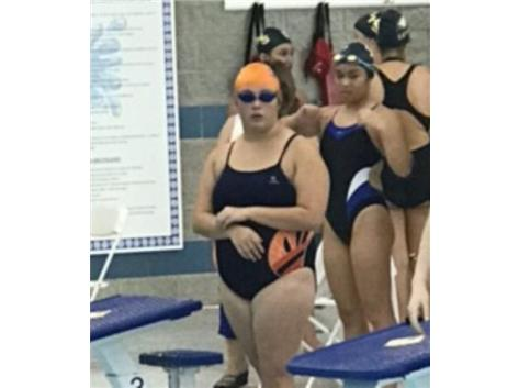 Preparing to swim the 100 Backstroke.