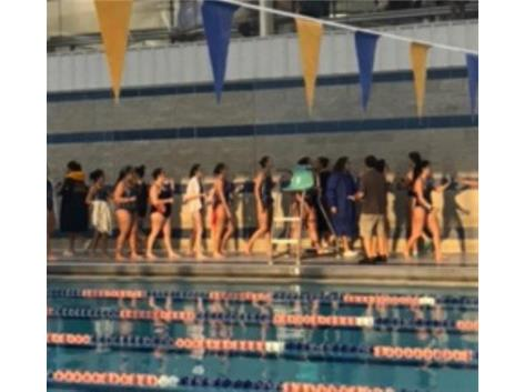 Teams congratulate each other after FHS vs Leyden Swim Meet.