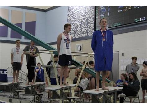 Nik (49.48) and Lucas (50.69) being awarded 3rd and 6th Place medals in 100 Freestyle at Conference Championship.