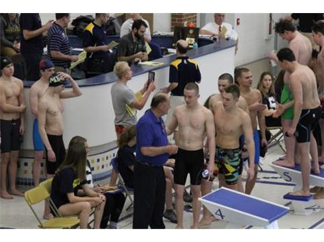 State Qualifying Medley Relay receiving awards from Coach Al at Glenbrook South Sectionals.