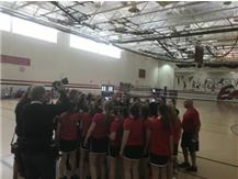 2016 vs. West Chicago (entire badminton program huddles)
