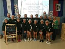 Varsity Girls' Tennis Team trade in racquets for hair nets and serve at Feed My Starving Children