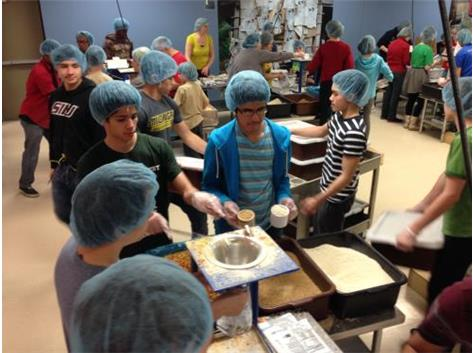 The Boys Gymnastics team at a Community Service project.