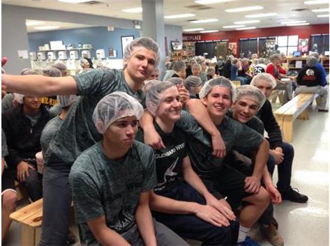 Boys Gymnastics team at Feed My Starving Children.