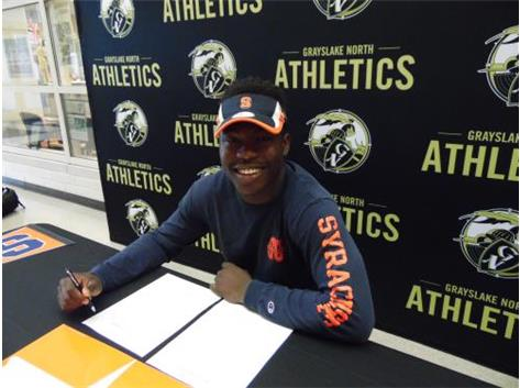 Dami Oladunmoye signs his letter of intent to play lacrosse at Syracuse.