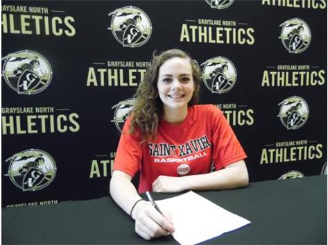 Sidney Lovitsch signs her letter of intent to play basketball at Saint Xavier University.