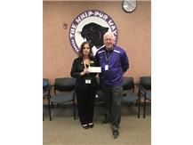 Heartland Bank provides donation to HHS.