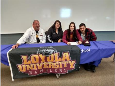 Peyton DeChant signs with Loyola University.