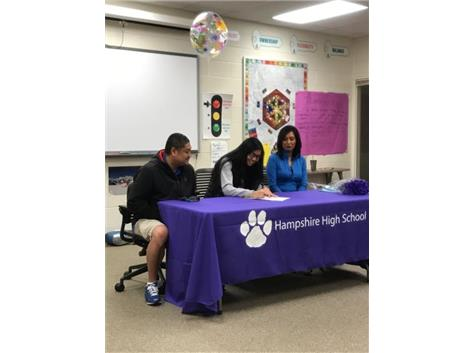 Louie Peralta signs with North Park College.