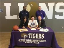 HCA Senior Brett Cramer signs national letter of intent to play collegiate basketball for Olivet Nazarene.