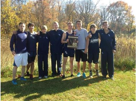 The 2014 HCA boys cross country team makes history by winning their first IHSA Regional Championship