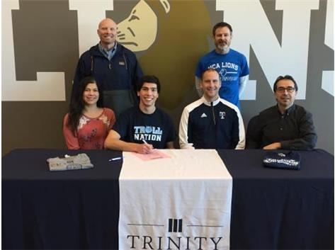HCA senior Andrew Dobrescu signs a national letter of intent to run Cross Country and Track & Field at Trinity Christian College