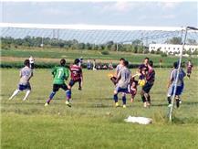 Herget Soccer defends their goal on a corner kick.
