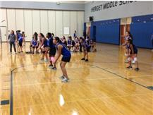 The 6th grade volleyball team prepares for a serve from Washington.