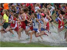 The girls run through the wet ground at Troy.