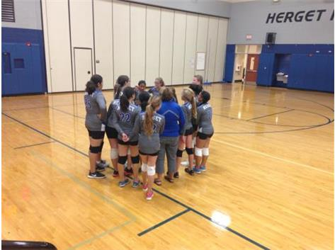 Herget huddles up to get ready for an intense game 3.