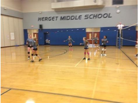 The 7th graders celebrate after the game winning point in the second game.