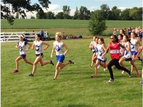The Herget girls cross country team starts their race.
