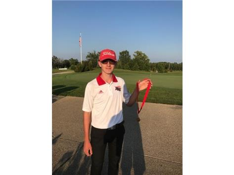 Jack Wagner holds his 10th place medal at the Huntley Invite at Blackstone Golf Club