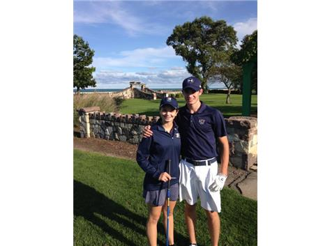 Maddie Hurt and John Hoffman awaiting their tee time, enjoying the scenic views of the Chicago shoreline
